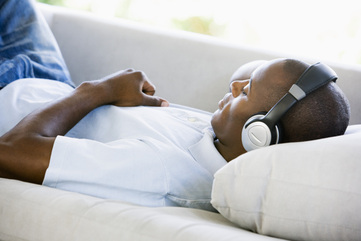 Person relaxing listening to binaural beats